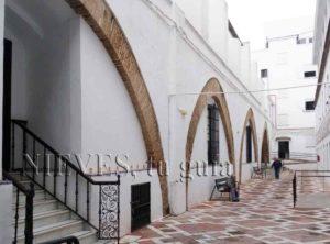 Muro con estructura Hospital de la Caridad